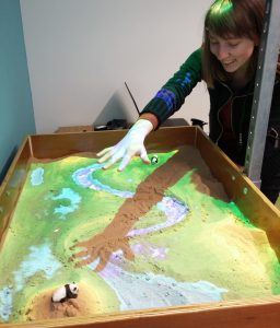 Elisa 'makes it rain' in the AR Sandbox