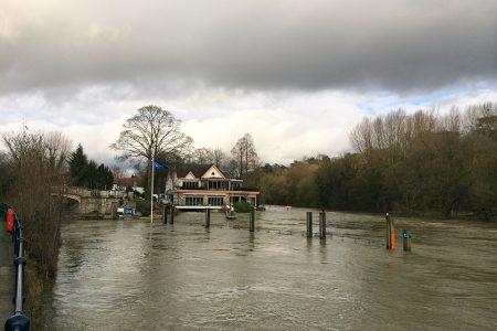 Human influence on climate in the 2014 Southern England winter floods and their impacts