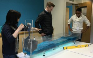 Students practice their wave tank demonstration skills